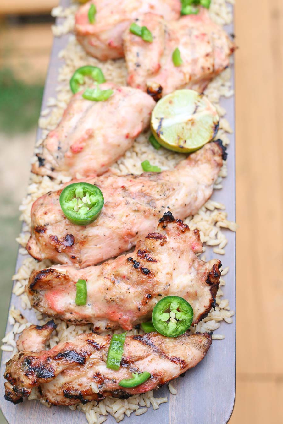 Grilled strawberry mango chicken with fresh jalapenos and grilled lime on a bed of fluffy brown rice!  This healthy delicious meal puts a light tropical flavor in every bite! image 2