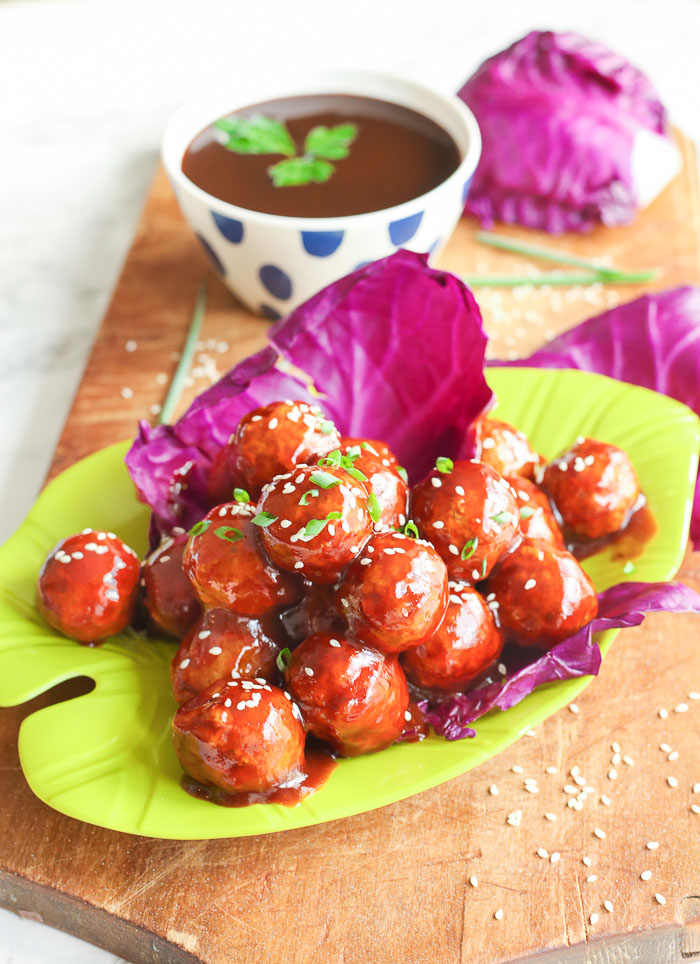 asian chicken meatballs on green serving plate