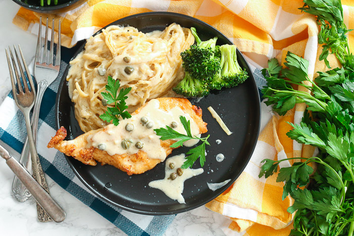 Gluten Free Chicken Piccata with Creamy Pasta in a plate