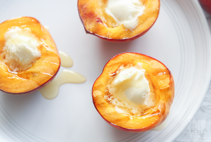 Gluten Free Grilled Peaches and Cream in a white plate