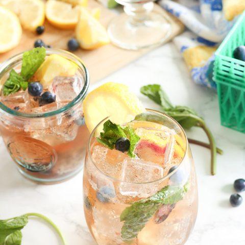 blueberry vanilla bourbon smash in cocktail glass