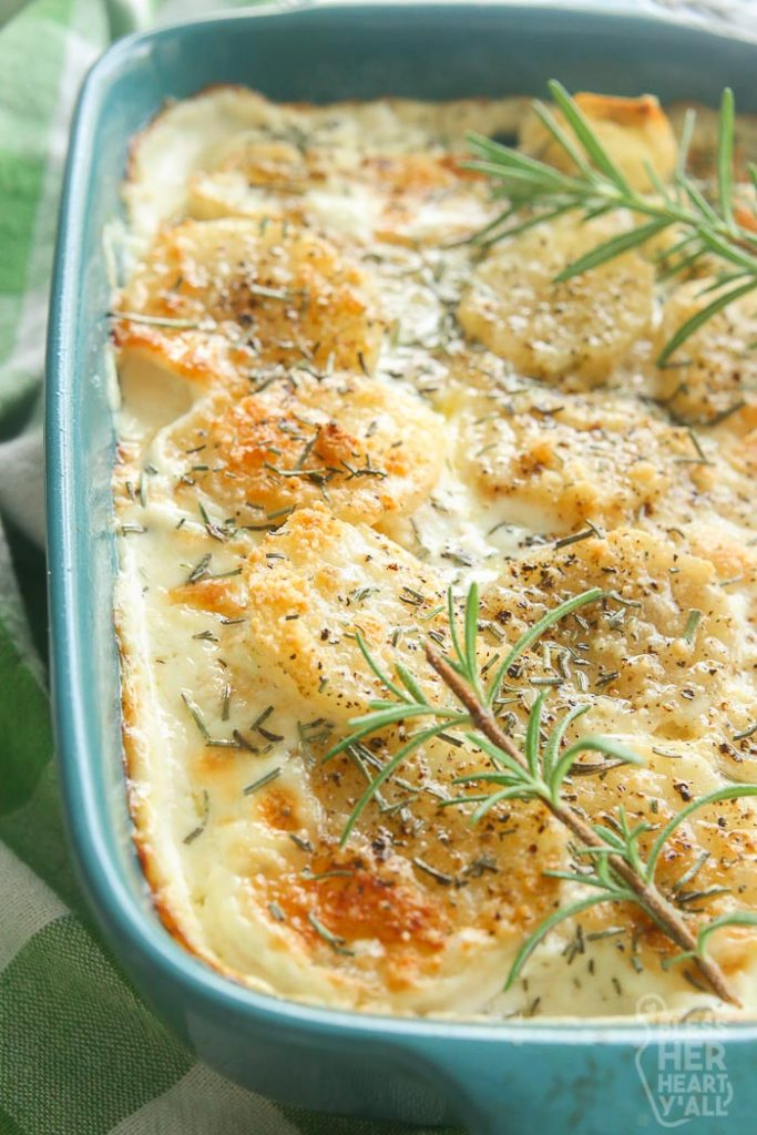 close up of scalloped potatoes in serving spoon